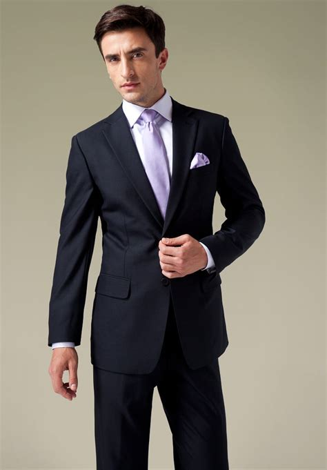 These shoes will have you looking professional no matter what you've got going on. Classic Navy Blue 2 button Wool Suit,$360