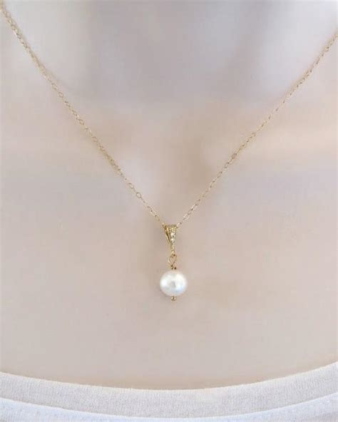 Swarovski Pearl Necklace, Gold Or Silver, Dainty Single. Color Change Sapphire Wedding Rings. Inspired The Ring Lord Wedding Rings. Uk Woman Engagement Rings. Real Silver Wedding Rings. Pink J Lo Engagement Rings. Flower Photography Engagement Rings. Understated Engagement Rings. Golden Cross Wedding Rings
