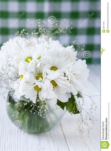 Bouquet Of White Flowers On The Kitchen Table Stock Image