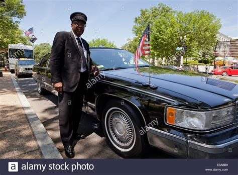 American Limousine by American Limousine Driver Standing Next To Car