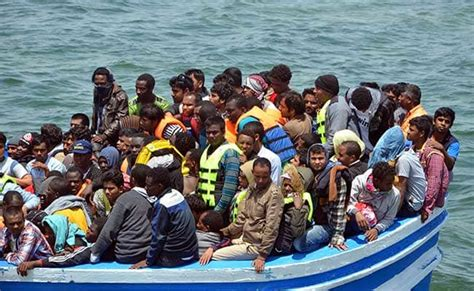 Overcrowded Refugee Boat by Tunisia Rescues 350 Migrants Heading By Boat To Italy From