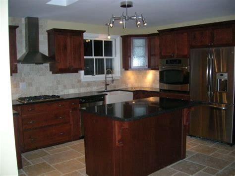 kitchen cherry cabinets black granite counters