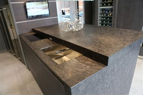 sliding worktop with hidden sink and hob, creates