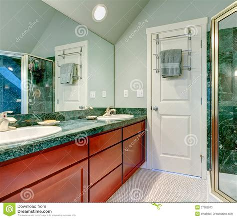 Refreshing Light Green Bathroom With Bright Brown Cabinets
