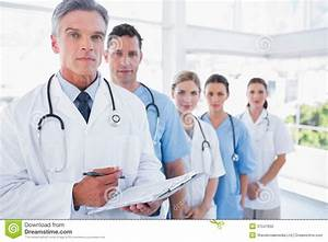 Serious Medical Team In Row Stock Photo - Image: 31547650