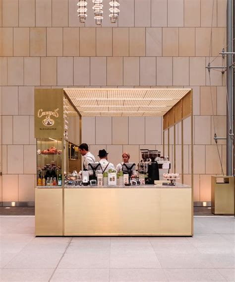 The only thing that makes a cup of hot coffee better is a walk in the woods. woods bagot positions brass coffee kiosk inside sydney tower