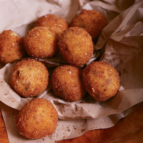 Crab stuffed mushrooms make the perfect party appetizer. Carolina Gold Rice Fritters with Chanterelles and Parmesan | Charleston Magazine in 2020 ...