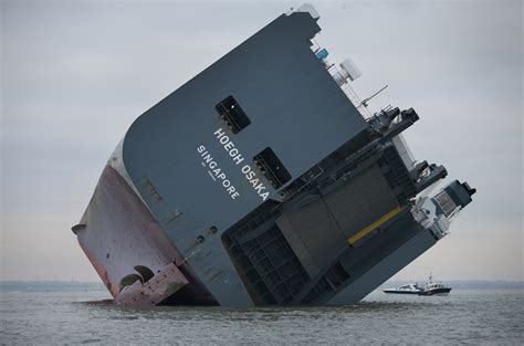 crew rescued  listing car carrier ship hoegh osaka