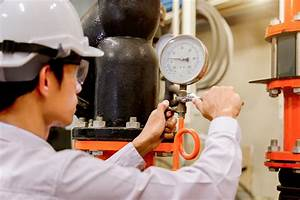 Engineer Checking Condenser Water Pump And Pressure Gauge