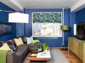 Small Living Room Ideas With Tv Small Living Room Design With Wooden Tv Cabinets And Small Grey Sofa Using Blue Wall Paint Color