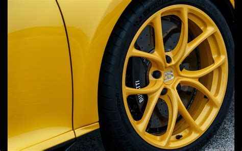The bugatti chiron has an (electronically limited) top speed of 261 mph, but most owners never get to experience that. 2018 Bugatti Chiron Yellow and Black | Serious Wheels