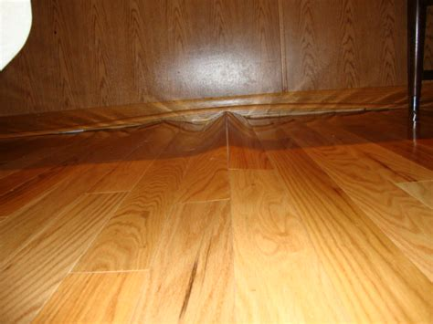 Wood Floor Cupping Water Damage by Laminate Flooring Buckled Laminate Flooring
