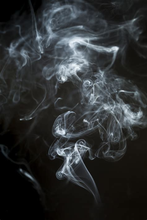 dark background  dynamic smoke silhouette photo