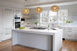 stainless steel topped kitchen islands island with string chandeliers cottage kitchen