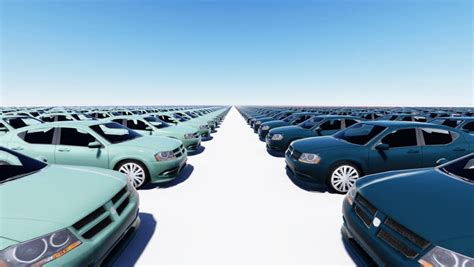 Many New Cars Of Different Bright Colors Parked In Rows