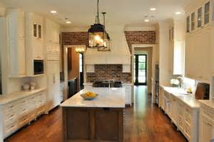 brick kitchen floor with white cabinets exposed brick wall traditional kitchen luxe living