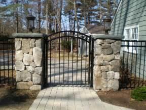 Wrought Iron Fence Gates with Stone Columns