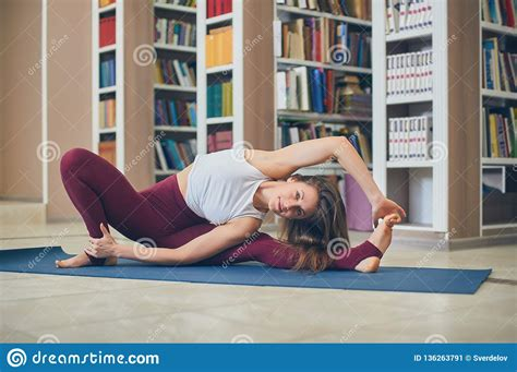 It is also called headstand pose which is one of the most important yoga poses. Beautiful Woman Practices Yoga Asana Parivrtta Janu Sirsasana - Breakdown Pose In The Library ...