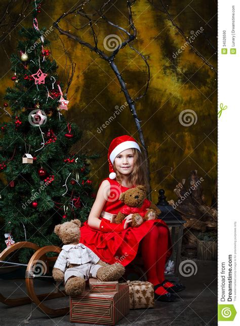 cute  girl  christmas decorations stock photo