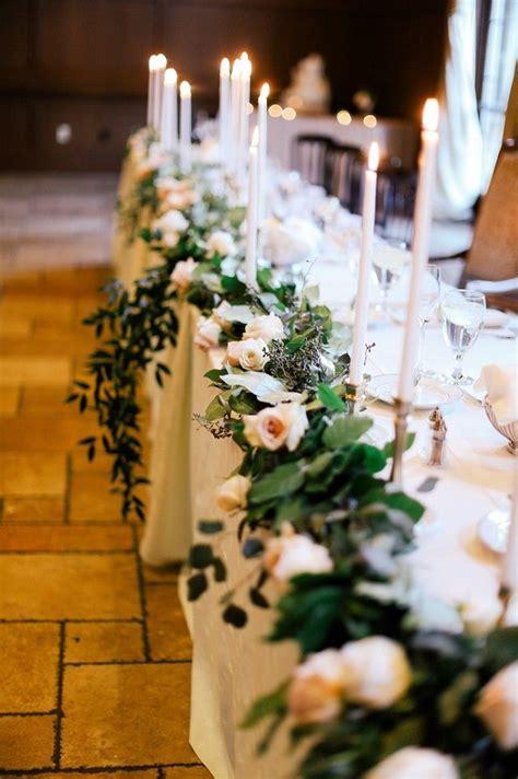 long head table  blush roses  green leaves