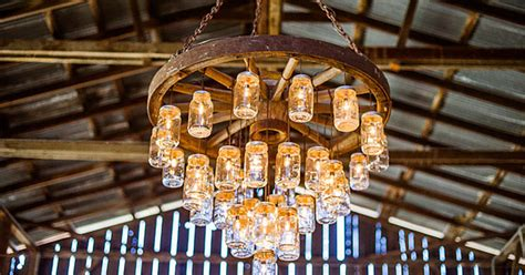 brilliant wagon wheel chandelier made with jars