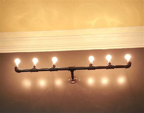 iron pipe light fixture pin by c kent on iron pipe pinterest