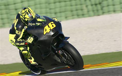 Rossi 46 On Black Bike Wallpaper