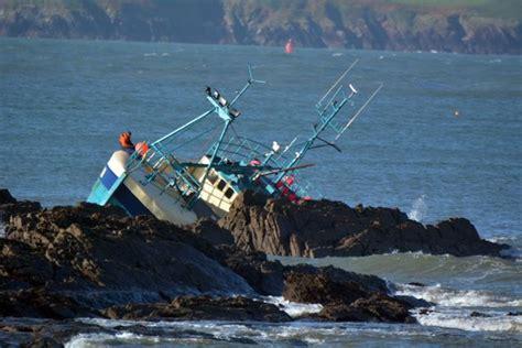 fishing vessel merchandise sinks fishermen rescued from sinking boat coast of