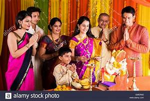 Indian family performing ganesh puja on ganesh chaturthi