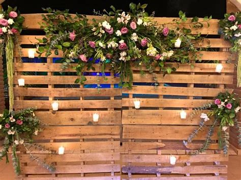 diy rustic wedding backdrop  faux flowers