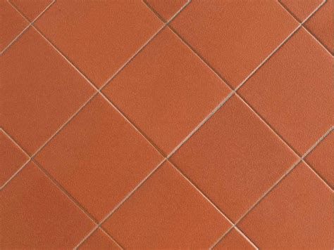 warm and inviting terracotta floor tiles kitchen cabinet