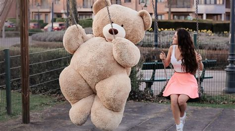 Download Wallpaper 1366x768 Teddy Bear And Girl Play Swing