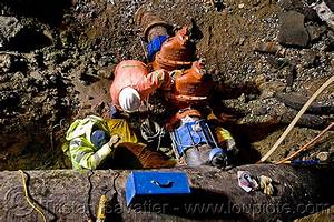 water main pipeline cut-off valves, utility workers fixing ...