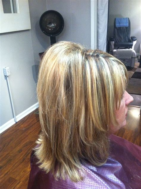 highlights and lowlights with a layered medium length cut