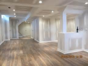 how to install laminate flooring in basement aggroup inc digenova basement laminate floor finished ready for paint