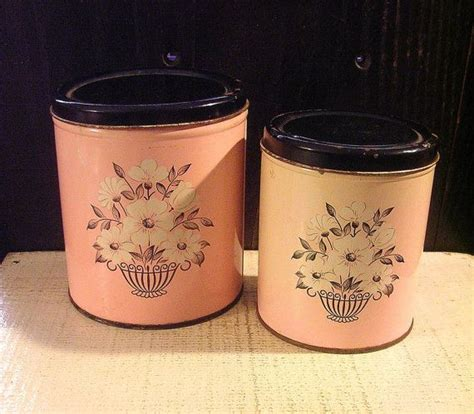 vintage metal kitchen canisters two pink vintage tin metal kitchen canisters