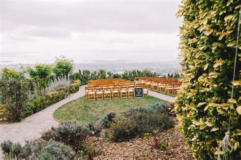 organic hillside diy wedding with navy gold tones in