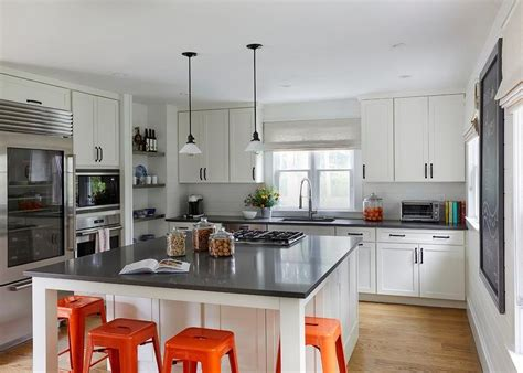 white square kitchen island  orange tolix stools