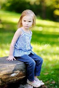 Angry little girl portrait outdoors | Stock Photo | Colourbox