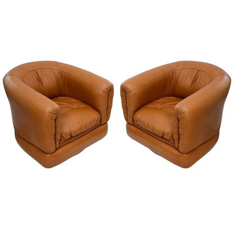 pair of 1970s barrel swivel leather chairs at