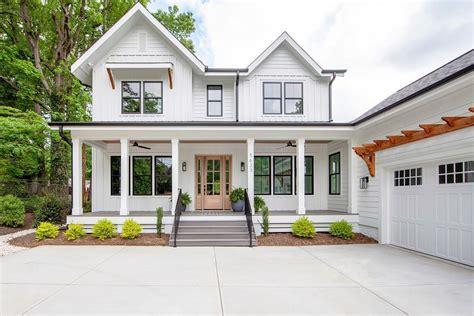 black double hung windows enhance classic farmhouse design pella