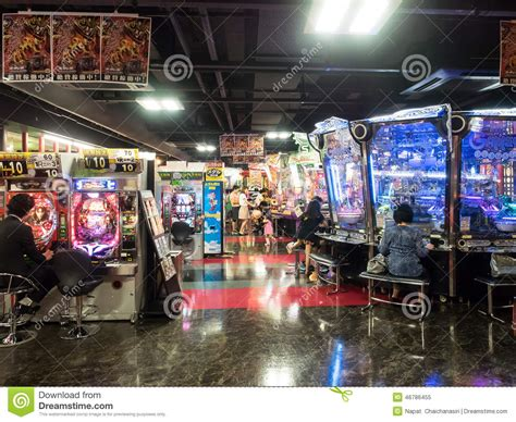 Unidentified People Playing Arcade Game Machine Editorial