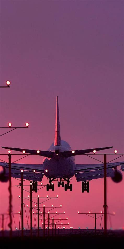 aircraft landing sunset 1080x2160 wallpaper
