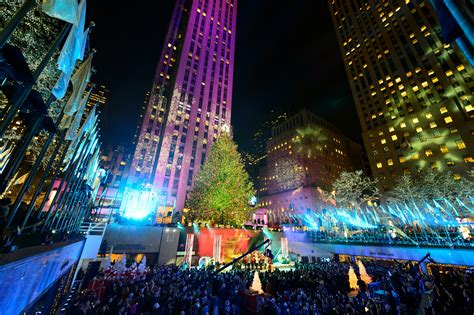 restaurant with view of christmas tree at rockefeller charitybuzz 2 passes to the rockefeller center tree