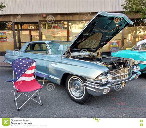 American Flag Lawn Chair Near A Classic Car At A Car Show