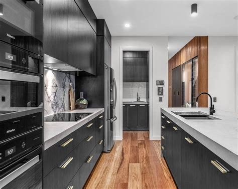 Cheap Cupboards Brisbane by Modern Black And White Kitchen With Contrasting Timber