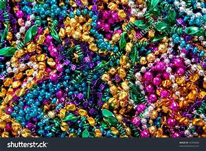 A Background Of Colorful Mardi Gras Beads Including Gold ...