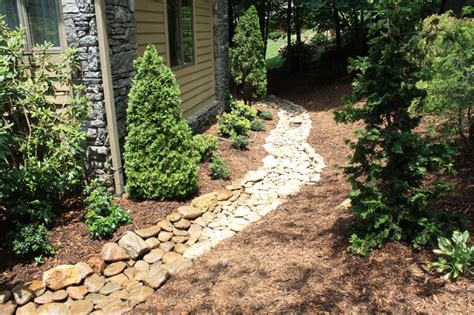 landscaping ideas for water runoff dry river rock bed ideas for the new house pinterest rivers beds and river rocks