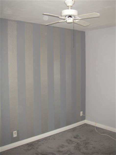 light grey walls w flat finish accented by a metallic
