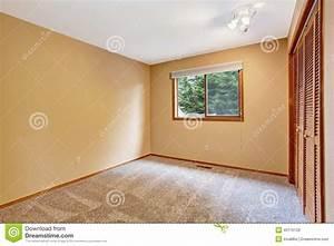 Empty Bedroom Interior In Soft Peach Color Stock Photo
